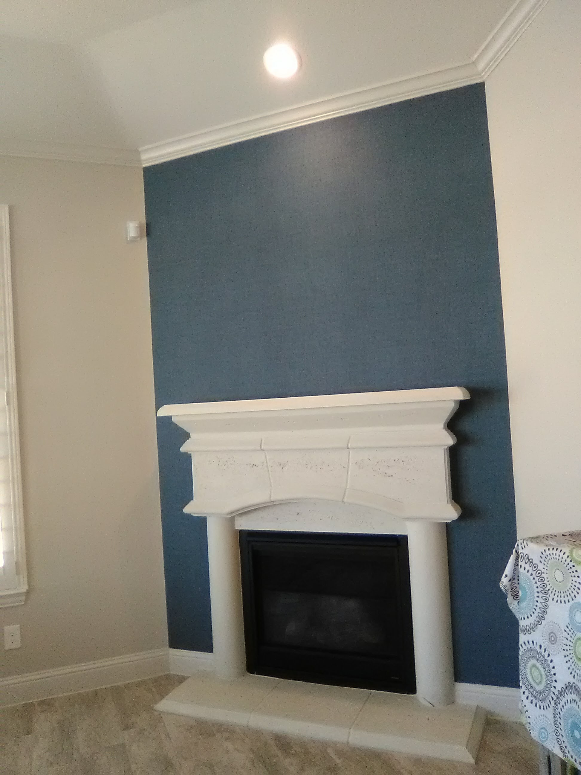 A Beautiful Faux Grasscloth Sets Off A Fireplace Wall