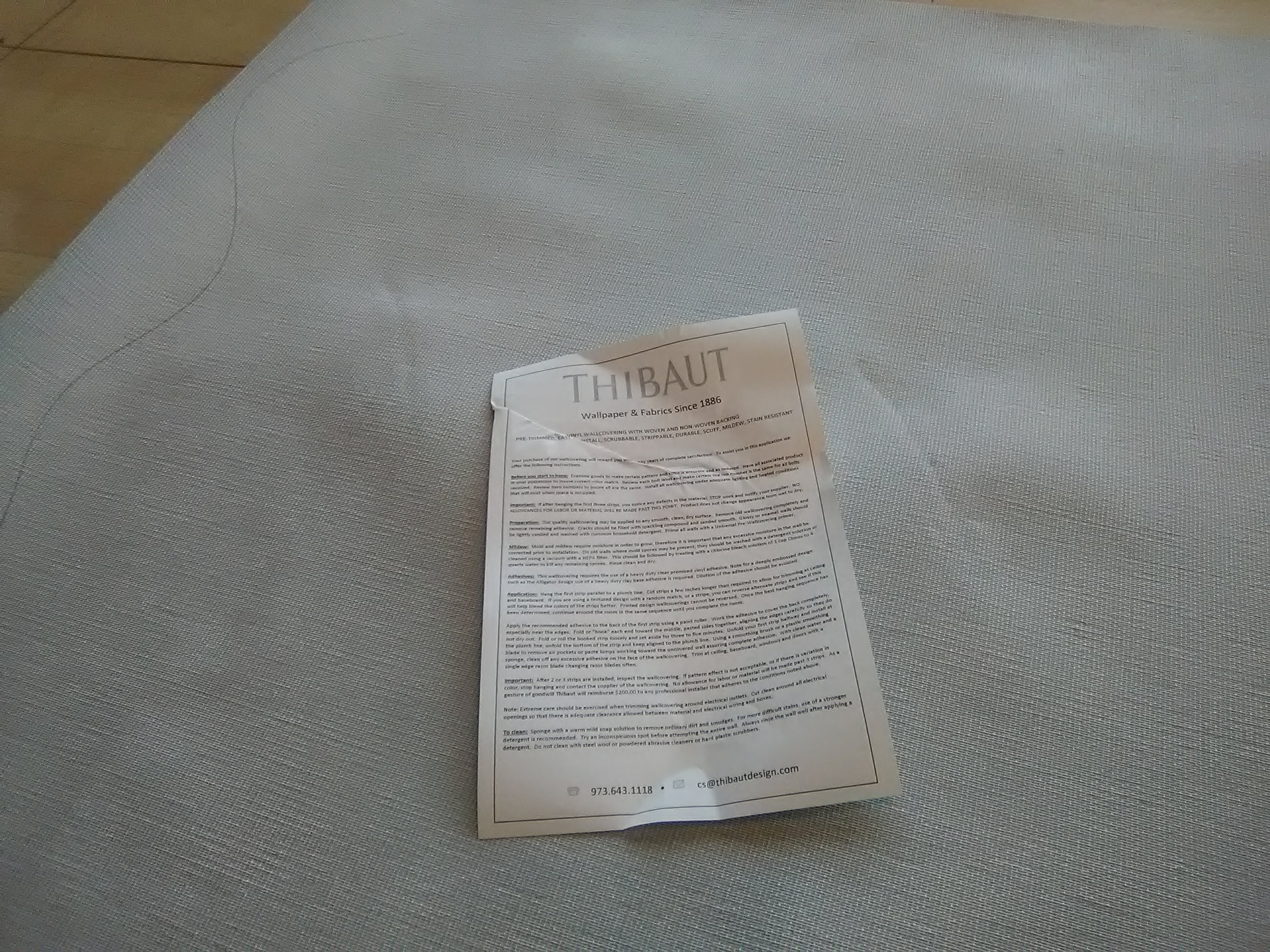 A Folded Instruction Sheet Damages The Wallpaper